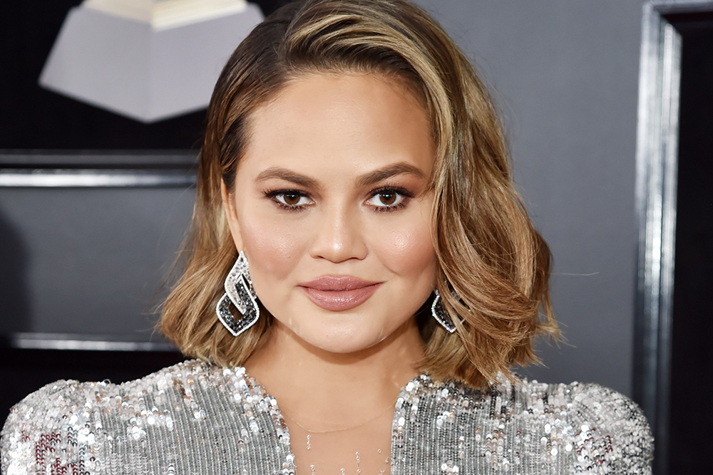 "Chrissy Teigen Just Posted a Naked Image of Her Post-Partum Body: ""This Is My New Body"" featured image"